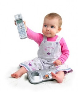 The small child with phone on a white background